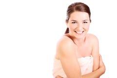 Smiling woman wearing bath towel Stock Photos