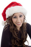 Smiling woman wearing christmas hat. Against white background Stock Image
