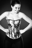 Smiling woman wearing a corset Stock Images