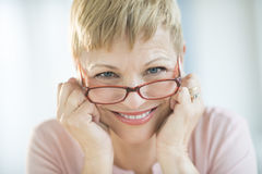 Smiling Woman Wearing Eyeglasses stock image