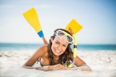 Smiling woman wearing flippers at the beach. On a sunny day Royalty Free Stock Photography