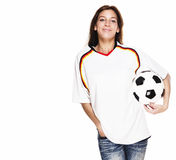 Smiling woman wearing football shirt with football Royalty Free Stock Images