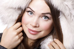 Smiling woman wearing fur Stock Photo