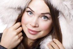 Smiling woman wearing fur Stock Photo