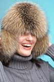 Smiling woman wearing fur-cap Royalty Free Stock Photography