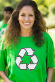 Smiling woman wearing green recycling t-shirt in park Stock Photo