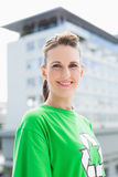 Smiling woman wearing green shirt with recycling symbol on it Royalty Free Stock Image