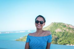 Smiling Woman Wearing Grey Striped Off-shoulder Top And Black Sunglasses royalty free stock photos