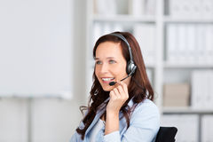 Smiling woman wearing a headset Stock Images