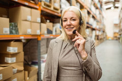 Smiling woman wearing a headset Stock Photography