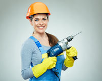 Smiling woman wearing helmet holding drill tool. Royalty Free Stock Photos