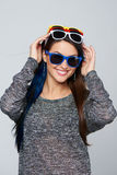 Smiling woman wearing many colourful sunglasses Stock Photography