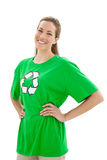 Smiling woman wearing a recycling symbol t-shirt. Smiling young woman wearing a recycling symbol t-shirt over white background Royalty Free Stock Photo