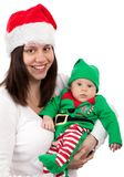Smiling Woman Wearing Santa Hat Carring Baby Wearing Elf Costume Royalty Free Stock Images