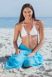 Smiling woman wearing sarong Royalty Free Stock Photo