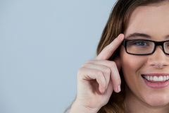 Smiling woman wearing spectacles Stock Image