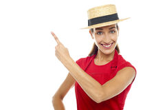 Smiling woman wearing straw bowler hat Stock Photography