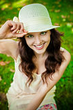 Smiling woman wearing a straw hat outdoors Royalty Free Stock Image
