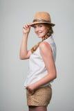 Smiling woman wearing summer straw fedora hat Stock Photo