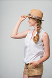Smiling woman wearing summer straw fedora hat Royalty Free Stock Images