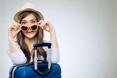 Smiling woman wearing sun glasses and hat. With suitcase stock photography