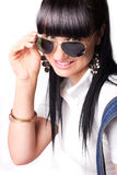 Smiling woman wearing sunglasses royalty free stock photography
