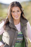 Smiling woman wearing vest outdoors Royalty Free Stock Photo
