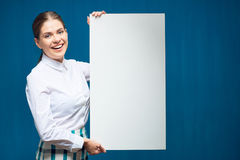 Smiling woman wearing white shirt holding advertising sign board Stock Photography
