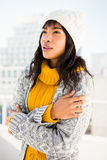 Smiling woman wearing winter clothes with arms crossed Stock Photos