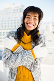 Smiling woman wearing winter clothes with arms crossed Royalty Free Stock Photography