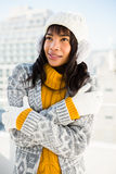 Smiling woman wearing winter clothes with arms crossed Royalty Free Stock Images