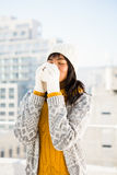 Smiling woman wearing winter clothes and drinking coffee Royalty Free Stock Photos