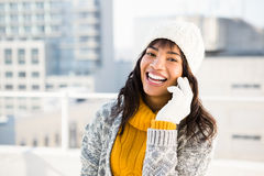 Smiling woman wearing winter clothes and having a phone call Royalty Free Stock Photos
