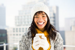 Smiling woman wearing winter clothes and holding coffee Stock Image