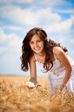 Smiling woman in wheat field Royalty Free Stock Photo