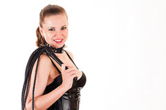 Smiling woman with a whip. Beautiful smiling woman with a whip Stock Photography