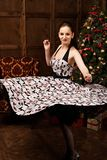 Smiling woman  whirling dancing over christmas tree Royalty Free Stock Photography