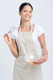 Smiling woman with whisk and baking bowl Royalty Free Stock Image