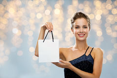 Smiling woman with white blank shopping bag Stock Photography