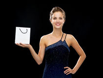 Smiling woman with white blank shopping bag Stock Image