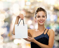 Smiling woman with white blank shopping bag Stock Photo
