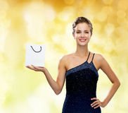 Smiling woman with white blank shopping bag Stock Images
