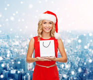 Smiling woman with white blank shopping bag Royalty Free Stock Photo
