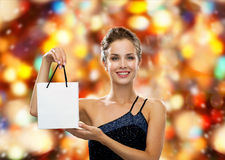 Smiling woman with white blank shopping bag. Luxury, advertisement, winter holidays, christmas and sale concept - smiling woman with white blank shopping bag Stock Photography