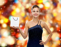 Smiling woman with white blank shopping bag. Luxury, advertisement, winter holidays, christmas and sale concept - smiling woman with white blank shopping bag Stock Photo