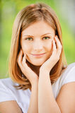 Smiling woman in white blouse Royalty Free Stock Photography