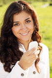 Smiling woman with white cellphone Royalty Free Stock Image