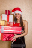 Smiling woman in white clothes with gift box Stock Image