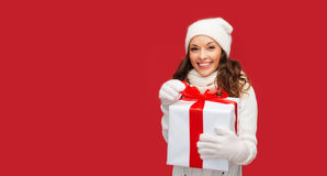 Smiling woman in white clothes with gift box Royalty Free Stock Photo