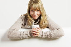 Smiling woman with white cup Stock Images